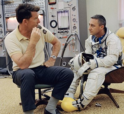 Astronaut Gus Grissom preparing for the Gemini III mission wearing his Omega Speedmaster, 1964